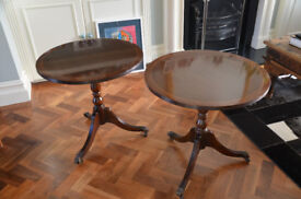 A pair of reproduction mahogony tables