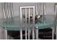Glass dining table /4 chairs