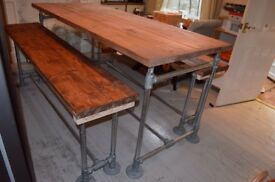 Large rustic kitchen island with benches