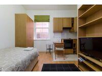 Modern ground floor studio apartment with open plan kitchen and en-suite shower/WC
