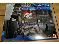 Brand new PS4 + 5 games + 2 years warranty.
