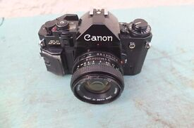 CANON A1 WITH 50MM LENS.ALL WORKING.CLEAN LENS THROUGHOUT.