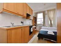 MODERN FURNISHED Studio flat with open plan kitchen and en-suite shower/wc. FREE WIFI and SKY TV