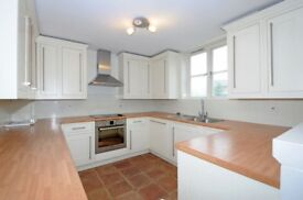 Aland Court - A modern split level three bedroom two bathroom apartment with dock views and parking