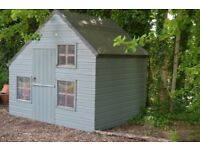 Stury wooden playhouse with upstairs