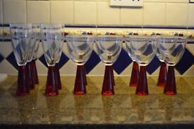Wine glasses with red base.