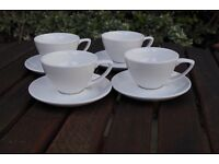 8 white breakfast coffee cups/saucers and milk jug