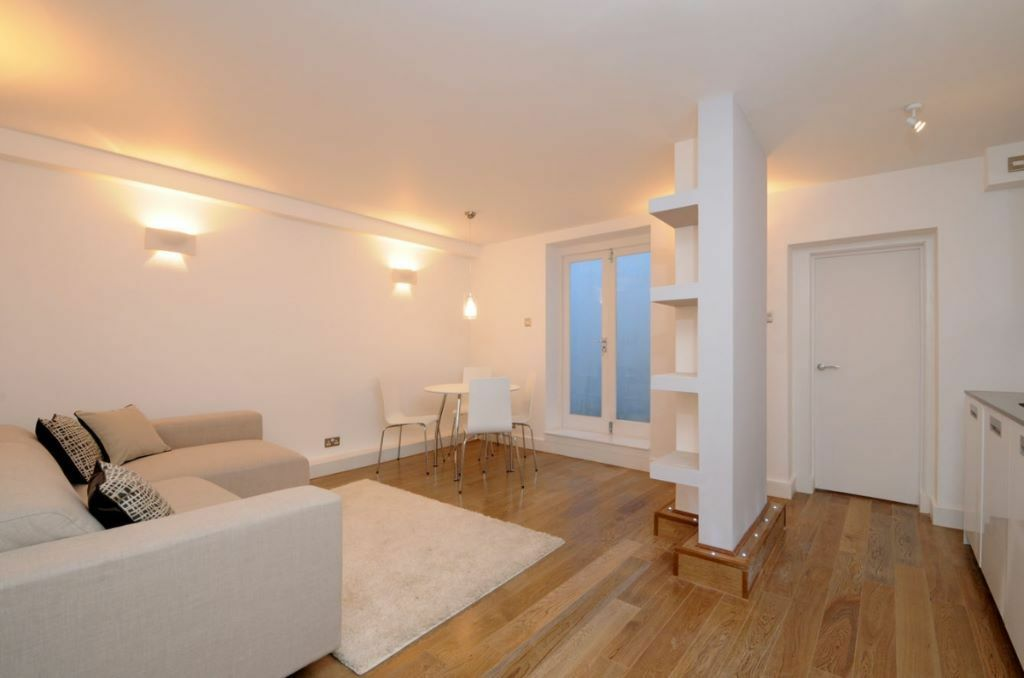 A recently renovated, two double bedroom flat, boasting private garden on Dawes Road, SW6