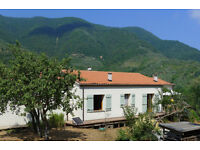 Italy -Italian Riviera, Liguria, offgrid solar artists 2 bed house and attached studio in 1.5 acres.