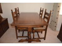 Oak Dining room table with 4 chairs and matching display cabinets