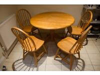 Dining table and four chairs-good condition- 7 dials