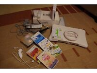 Nintendo wii white with lots of accessories + fit board