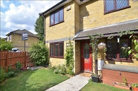 LOVELY 3 BEDROOM House in a quiet mews, Large private garden and private parking , close to train.