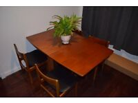 Solid Teak MCINTOSH Mid-Century 1970's Drop Leaf Dining Table and four teak chairs