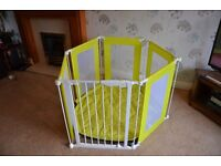 Yellow and white playpen including quilted play mat