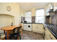 A bright and spacious three bedroom flat in red brick mansion block 2 mins to Barons Court station