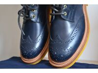Brand new black Trickers leather brogue ankle boots with yellow soles. With Trickers stuff bags.