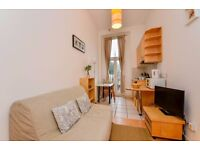 Split level studio flat with open plan kitchen and en-suite shower/WC. FREE WIFI and SKY TV.