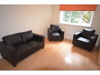 brown pseudo leather sofa and 2 matching armchairs
