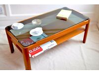 Vintage two-tier teak and smoked glass coffee table. Delivery. Danish / mid century style.