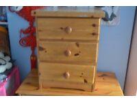 Solid pine bedside cabinet.