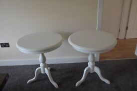2 white coffee tables.