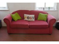 Medium sized red sofa bed