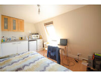 091T-BARONS COURT-WEST KENSINGTON, DOUBLE STUDIO FLAT, BILLS INCLUDED, FURNISHED - £200 WEEK