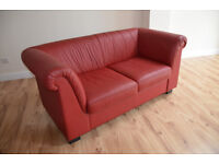 Leather Sofa in red .