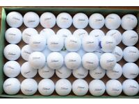 50 used Titleist Velocity golf balls in casual game/practice condition.