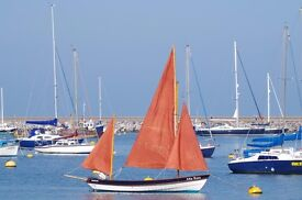 Devon Lugger for sale includes outboard engine and trailer. Ready to sail.