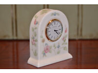 Wedgwood rosehip china dome clock.. 5inches tall.