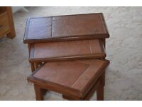 Nest of three side tables with tiled tops in teak