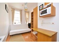 COMFORTABLE second floor self contained studio flat with open plan kitchen and en-suite bathroom.