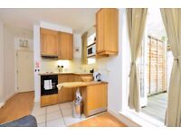 MODERN studio flat with open plan kitchen, en-suite shower/WC and private PATIO.
