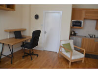 Desks to rent in central office, 5 minutes walk from Haymarket, Internet and bills included.