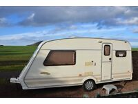 For sale two birth Fleetwood Colchester caravan with large awning good clean condition no damp