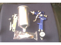 HVLP spray gun with 2 nozles and air rods for primer and finishing, new in box.