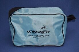 Seven blue Stag Turf Pro hockey balls including matching Stag bag.