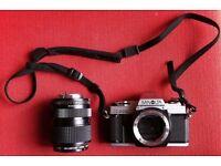 Minolta X-300 SLR Camera body with Minolta MD lens