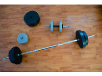 Barbell with 50 kg of weights and spinlocks