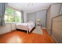 Large double bed to rent in a homely house with Large lounge, dining room and garden