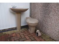 Wash hand basin with taps and matching toilet and cistern
