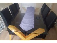 Glass Dining Room table with 6 Leather Chairs