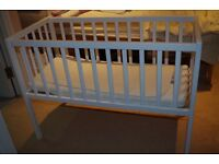 Cot with bedding and anti 'Flat Head' Pillow