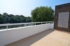 Available Now - Heating & Hot Water Included! Four Bedrooms with Garage Parking & Direct River Views