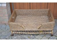 Two wicker dog baskets (one with memory foam bed)