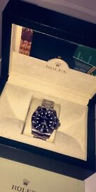Rolex Submariner, swooping movement comes with box and accessories