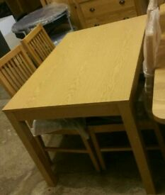 A brand new extending table with 4 chairs.
