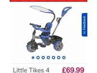 Little tikes 4 in 1 trike with original box and raincovers